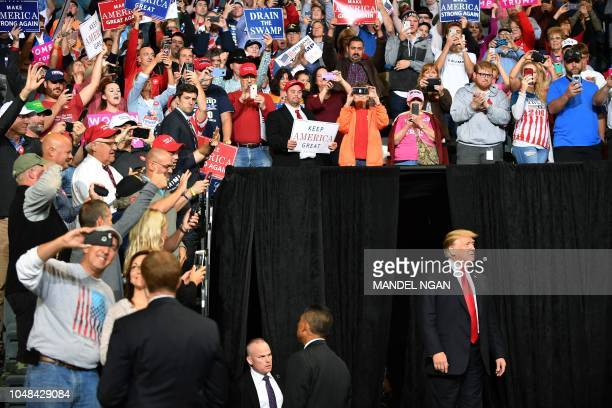 President Donald Trump arrives on stage for a rally at the MidAmerica Center in Council Bluffs Iowa on October 9 2018
