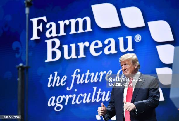 US President Donald Trump arrives on stage to address the annual American Farm Bureau Federation convention in the Ernest N Morial Convention Center...