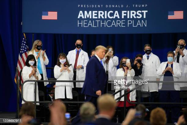 S President Donald Trump arrives on stage to deliver remarks on his healthcare policies on September 24 2020 in Charlotte North Carolina Trump's trip...