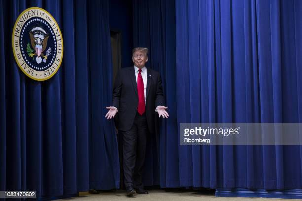 S President Donald Trump arrives to a signing ceremony for HR 2 Agriculture Improvement Act of 2018 at the White House in Washington DC US on...
