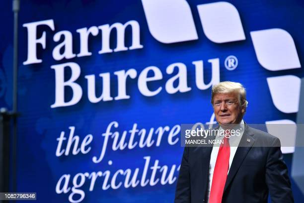 US President Donald Trump arrives to address the annual American Farm Bureau Federation convention in the Ernest N Morial Convention Center in New...