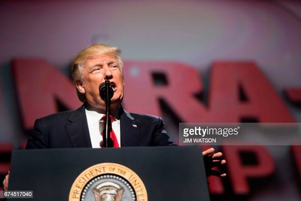 US President Donald Trump arrives to address the National Rifle Association Leadership Forum in Atlanta Georgia on April 28 2017 / AFP PHOTO / JIM...