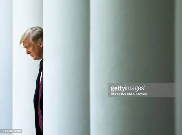 US President Donald Trump arrives to announce a new immigration proposal in the Rose Garden of the White House in Washington DC on May 16 2019 Trump...