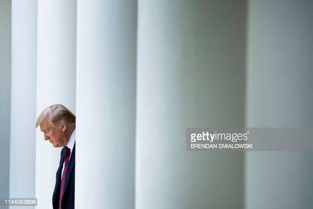 President Donald Trump arrives to announce a new immigration proposal in the Rose Garden of the White House in Washington DC on May 16 2019 Trump...