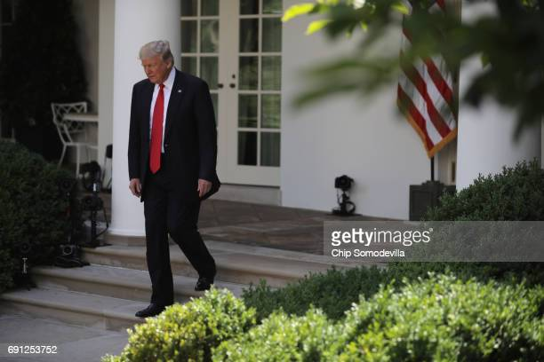 S President Donald Trump arrives to announce his decision regarding the United States' participation in the Paris climate agreement in the Rose...