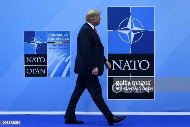 President Donald Trump arrives to attend the NATO summit, in Brussels, on July 11, 2018.