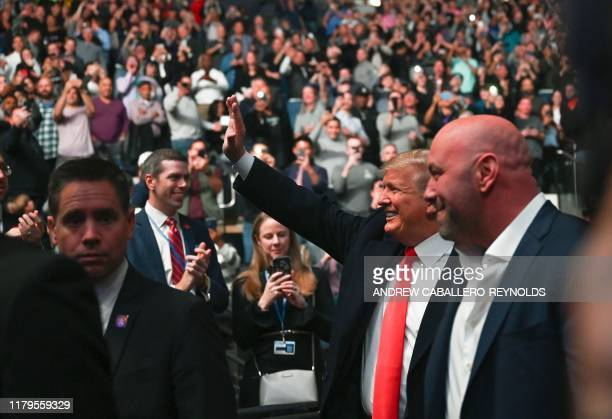US President Donald Trump arrives to attend the Ultimate Fighting Championship at Madison Square Garden in New York City New York on November 2 2019