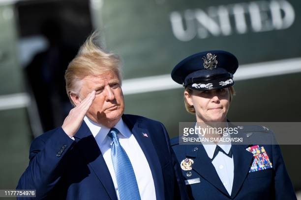 US President Donald Trump arrives to board Air Force One at Joint Base Andrews in Maryland on October 23 as he travels to Pittsburgh Pennsylvania
