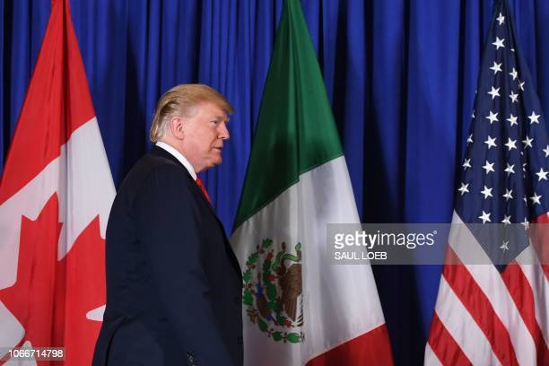US President Donald Trump arrives to deliver a statement along with Mexican President Enrique Pena Nieto and Canadian Prime Minister Justin Trudeau...