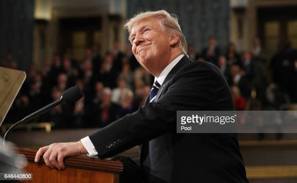 US President Donald Trump arrives to deliver an address to a joint session of the US Congress on February 28 2017 in the House chamber of the US...