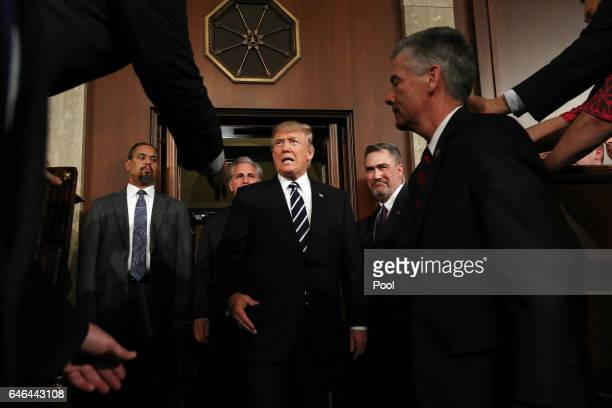 President Donald Trump arrives to deliver an address to a joint session of the U.S. Congress on February 28, 2017 in the House chamber of the U.S....