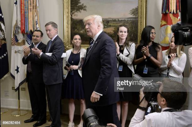 S President Donald Trump arrives to deliver remarks on his executive order that aims to expand apprenticeships to train people for millions of...