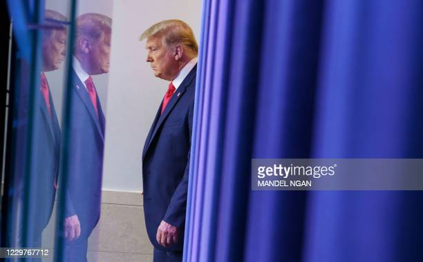 President Donald Trump arrives to deliver remarks on the stock market during an unscheduled appearance in the Brady Briefing Room of the White House...