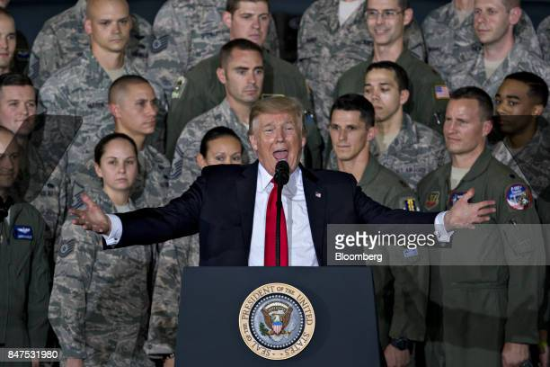 US President Donald Trump arrives to deliver remarks to military personnel and families in an aircraft hangar at Joint Base Andrews Maryland US on...