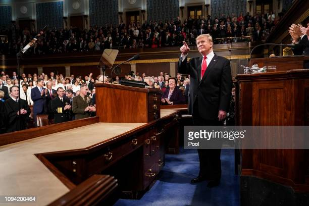 S President Donald Trump arrives to deliver the State of the Union address in the chamber of the US House of Representatives at the US Capitol...