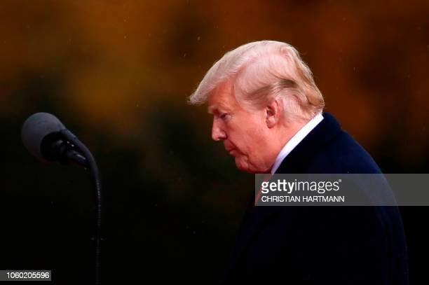 US President Donald Trump arrives to give a speech as he visits the American Cemetery of Suresnes outside Paris on November 11 2018 as part of...
