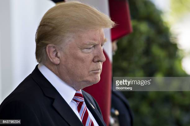 US President Donald Trump arrives to greet Sheikh Sabah AlAhmed AlSabah Kuwait's emir not pictured at the West Wing of the White House in Washington...