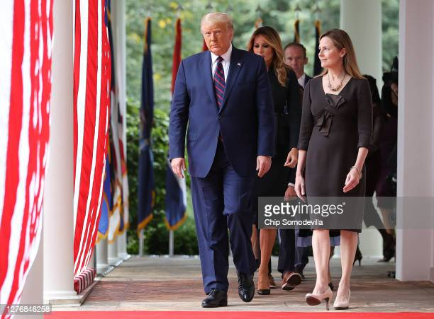 President Donald Trump arrives to introduce 7th U.S. Circuit Court Judge Amy Coney Barrett as his nominee to the Supreme Court in the Rose Garden at...