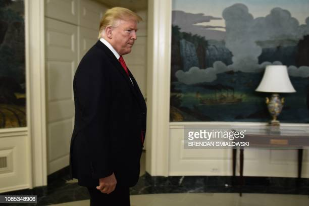US President Donald Trump arrives to make an announcement on the budget the government shutdown immigration and the border January 19 2019 at the...