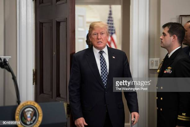 President Donald Trump arrives to sign a proclamation to honor Martin Luther King Jr day in the Roosevelt Room at the White House in Washington DC on...
