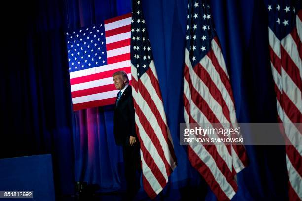US President Donald Trump arrives to speak about tax reform at the Indiana Farm Bureau building on the Indiana State Fairgrounds September 27 2017 in...
