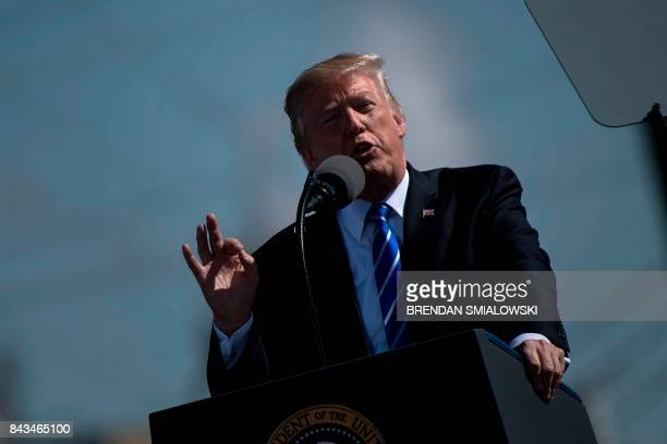 US President Donald Trump arrives to speak about the need for tax reform at Andeavor Refinery September 6 in Mandan North Dakota / AFP PHOTO /...