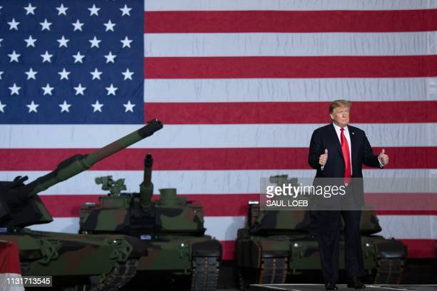 President Donald Trump arrives to speak after touring the Lima Army Tank Plant at Joint Systems Manufacturing in Lima Ohio March 20 2019