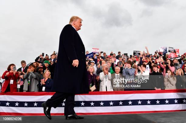 President Donald Trump arrives to speak at a campaign rally at the Huntington Tri-State Airport, on November 2 in Huntington, West Virginia.
