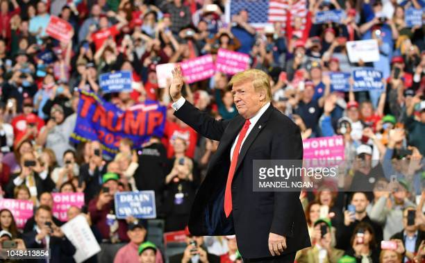 President Donald Trump arrives to speak at a Make America Great Again rally at the MidAmerica Center in Council Bluffs Iowa on October 9 2018