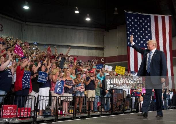 US President Donald Trump arrives to speak at a Make America Great Again Rally at Big Sandy Superstore Arena in Huntington West Virginia August 3...