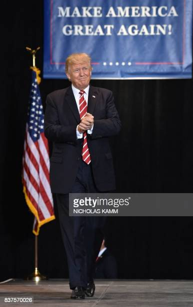 US President Donald Trump arrives to speak at a 'Make America Great Again' rally in Phoenix Arizona on August 22 2017 / AFP PHOTO / Nicholas Kamm