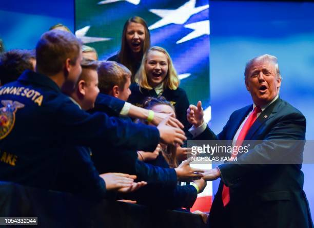 US President Donald Trump arrives to speak at the Future Farmers of America convention on October 27 2018 in Indianapolis Indiana