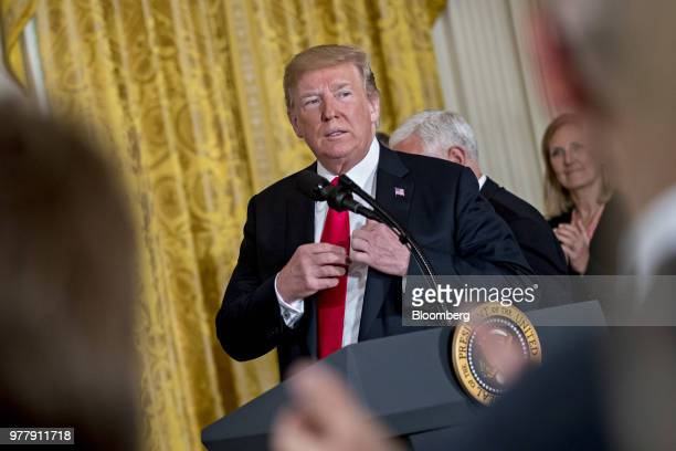 US President Donald Trump arrives to speak during a National Space Council meeting in the East Room of the White House in Washington DC on Monday...
