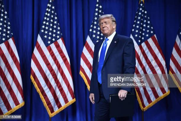 President Donald Trump arrives to speak during the first day of the Republican National Convention on August 24 in Charlotte, North Carolina.