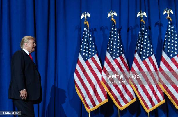 US President Donald Trump arrives to speak during the National Association of Realtors Legislative Meetings and Trade Expo in Washington DC on May 17...