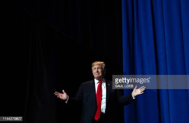 US President Donald Trump arrives to speak during the National Association of Realtors Legislative Meetings and Trade Expo in Washington DC May 17...