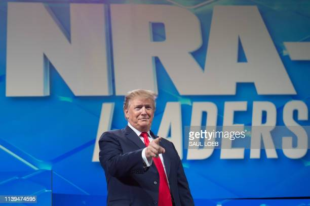 US President Donald Trump arrives to speak during the National Rifle Association Annual Meeting on April 26 at Lucas Oil Stadium in Indianapolis...