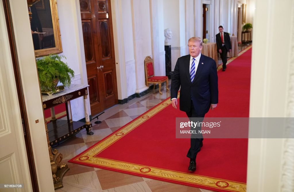 US President Donald Trump arrives to speak during the Public Safety Medal of Valor Awards Ceremony in the East Room of the White House on February 20, 2018 in Washington, DC. NGAN