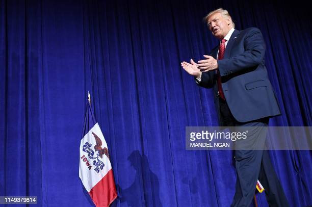 US President Donald Trump arrives to speak during the Republican Party of Iowa Annual Dinner at The Ron Pearson Center in West Des Moines Iowa on...