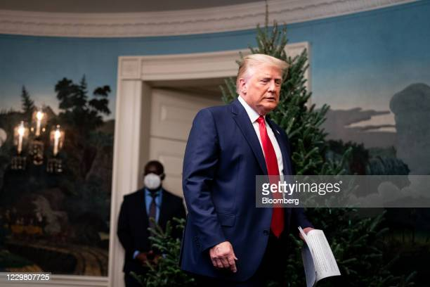 President Donald Trump arrives to speak to members of the military on a videoconference in the Diplomatic Room of the White House in Washington,...