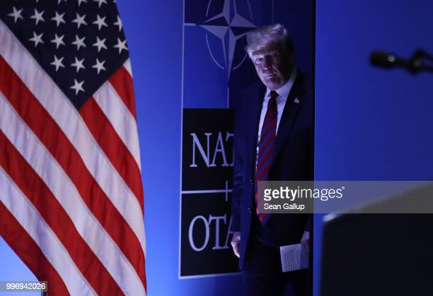 S President Donald Trump arrives to speak to the media at a press conference on the second day of the 2018 NATO Summit on July 12 2018 in Brussels...