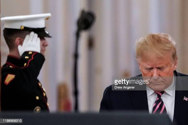 S President Donald Trump arrives to speak to the media in the East Room of the White House one day after the US Senate acquitted him on two articles...