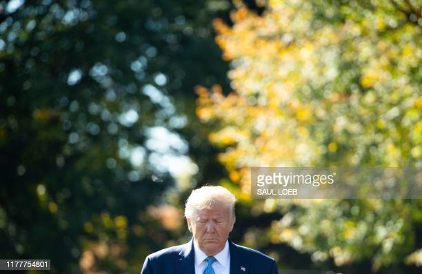 US President Donald Trump arrives to speak to the media prior to departing on Marine One from the South Lawn of the White House in Washington DC...