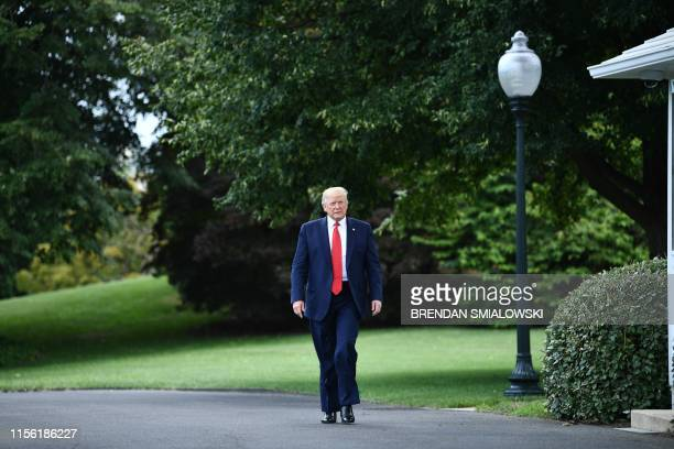 US President Donald Trump arrives to speak to the press as he departs the White House in Washington DC on July 17 2019 Trump travels to Greenville...