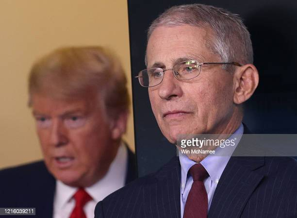 S President Donald Trump arrives to speak while flanked by Dr Anthony Fauci director of the National Institute of Allergy and Infectious Diseases...