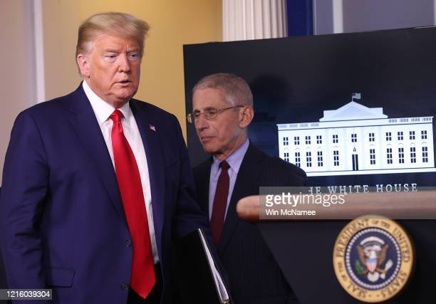 President Donald Trump arrives to speak while flanked by Dr. Anthony Fauci , director of the National Institute of Allergy and Infectious Diseases,...
