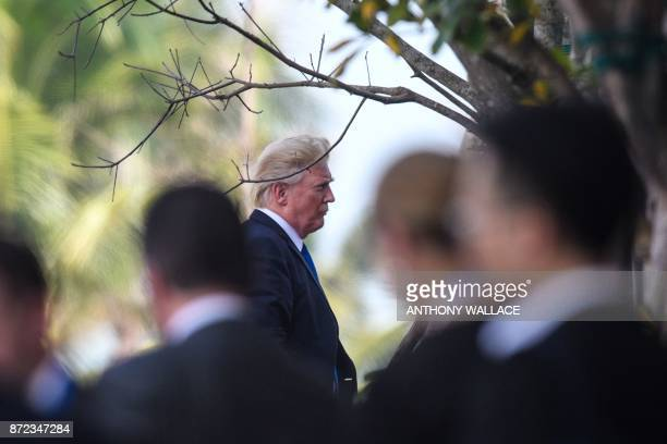 President Donald Trump arrives to the venue to speak on the final day of the APEC CEO Summit part of the broader AsiaPacific Economic Cooperation...