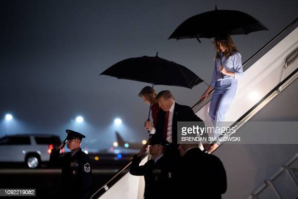 US President Donald Trump arrives with Barron Trump and US first lady Melania Trump at Palm Beach International Airport February 1 2019 in Palm Beach...