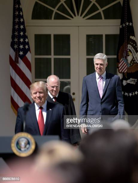 US President Donald Trump arrives with Justice Anthony Kennedy before Justice Kennedy administers the oath of office to Neil Gorsuch as an associate...