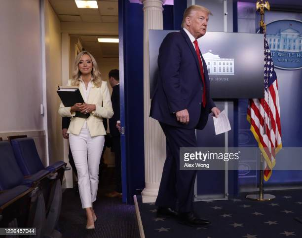 S President Donald Trump arrives with White House Press Secretary Kayleigh McEnany to make a statement in the briefing room at the White House on May...